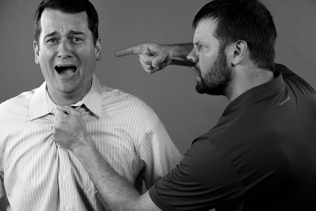 An man yelling at an other man